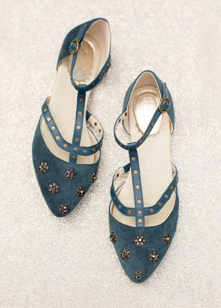Strapped and studded, featuring antique brass embellishments with beautiful  jewels, these unique flats will make a statement with every ensemble. The deep teal hue is sure to make a statement with any ensemble.
