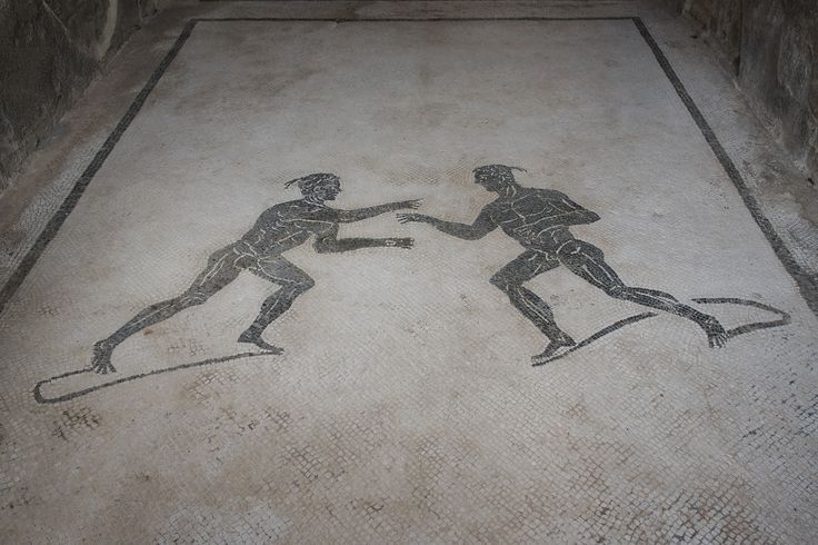 Il mosaico all'ingresso della palestra degli scavi di Pompei | © Anna Monaco (@annafdf)  - Campaniasuweb
