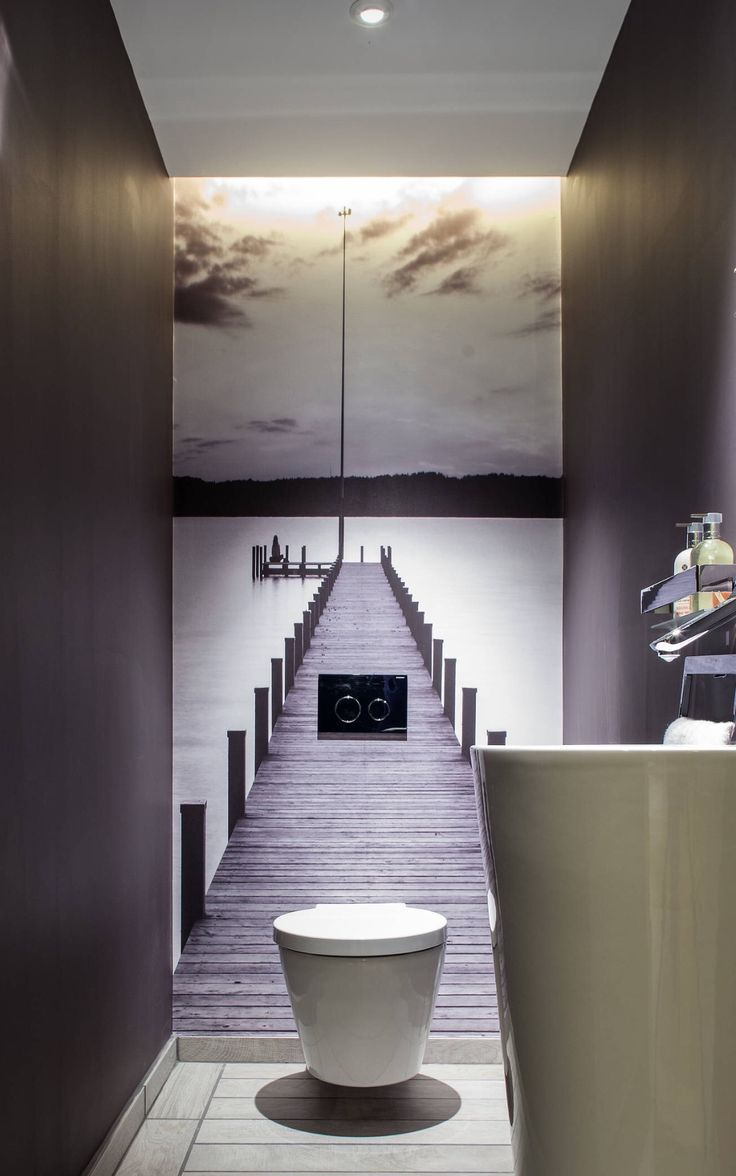 Guest bathrooms don't have to be dull - dare to be a bit more creative with a striking wall print.