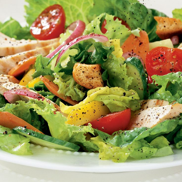 Use your favorite mix of crisp salad greens and salad dressing in this colorful, main dish salad topped with chicken strips. Crushed peppercorns add a pleasant boost of flavor.
