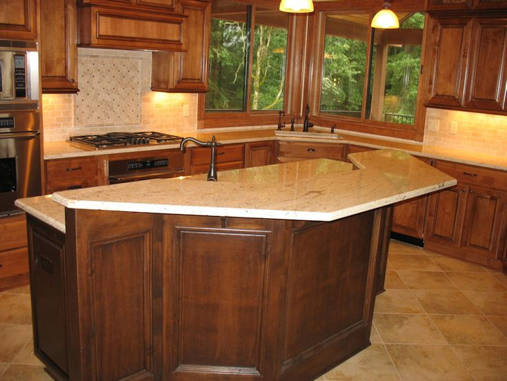 Colonial cream granite kitchen with cherry cabinets and tile backsplash kitchen pinterest - Black granite countertops with cream cabinets ...