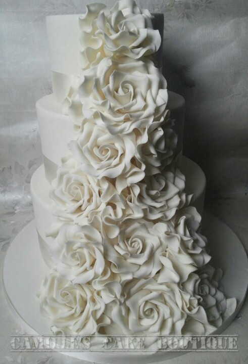 Ruffles and roses white wedding cake