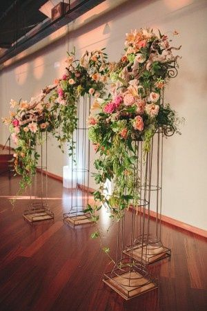floral arrangments on the wedding pillars for modern wedding ceremony backdrop