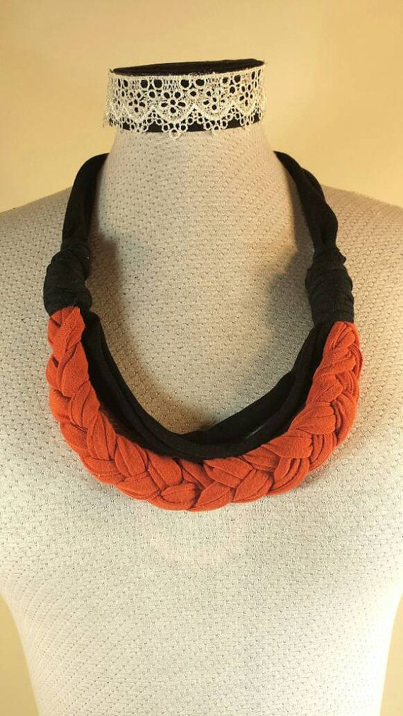 Check out this item in my Etsy shop https://www.etsy.com/ca/listing/272810526/black-and-orange-braided-tshirt-necklace