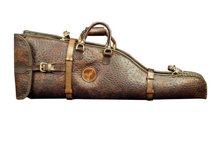 This Double Leather Takedown Shotgun Case is made of faux ostrich skin. Holds up to 30″ barrels.  Complete with leather straps closing the case with gold buckles.   Features a durable leather removable carrying strap as well as handles with gold finishing. The interior is a soft suede material.   The total length of this double takedown case is 35″.   Available in Dark Brown.  $2,299.00