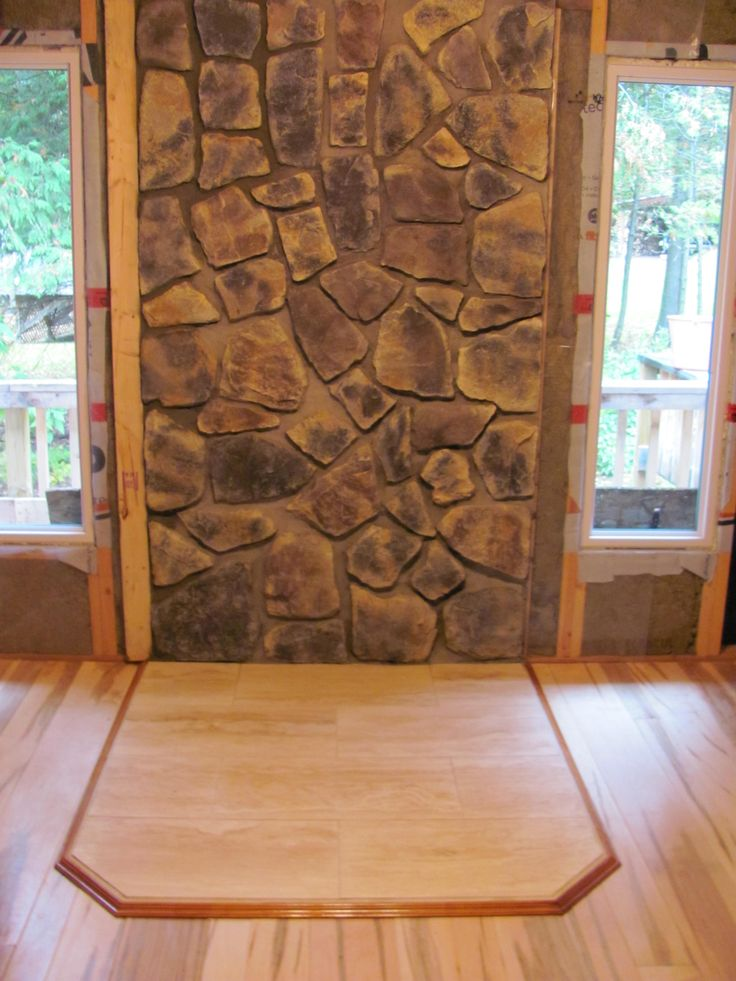 Stone Wall Behind Woodstove And New Windows Flanking Wood