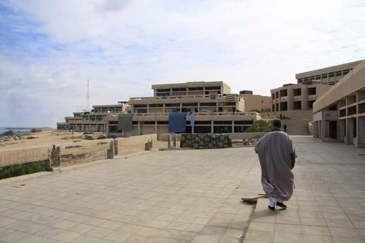 A middle-aged man from the deserted town of Tawergha strolls around a former marine academy where hundreds of internally displaced people are staying. ©UNHCR/L.Dobbs