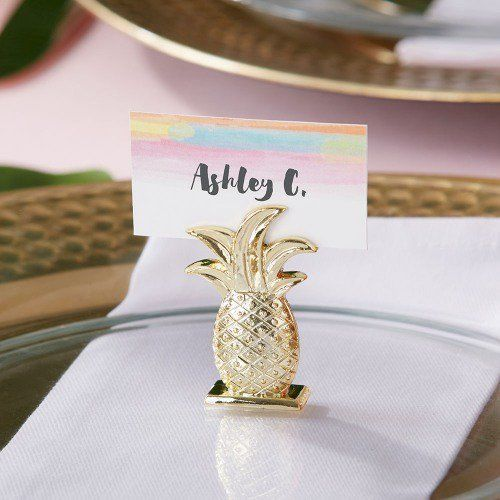 Let your wedding guests take a seat in tropical paradise with these pineapple place card holders. Not only are they super cute, they're functional and the perfect party favor. | Pineapple Place Card Holders