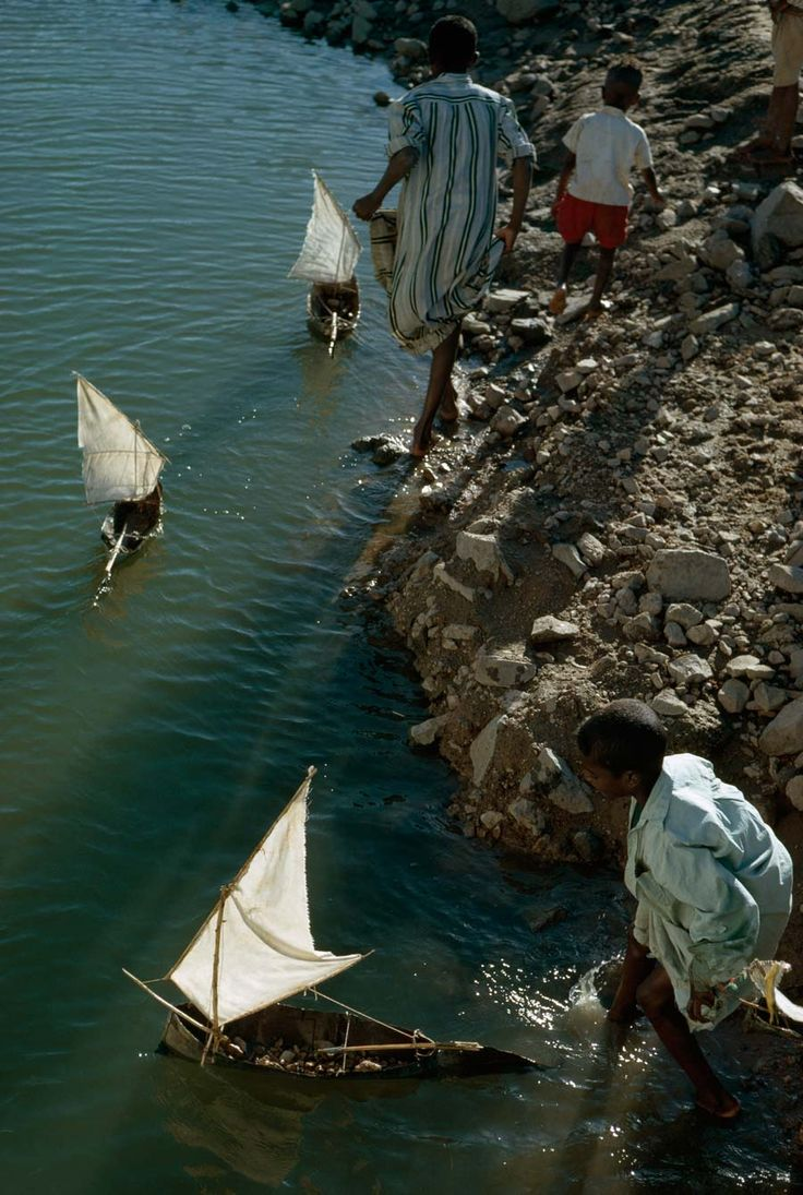 Boys Play With Toy Sailboats Along The Nile South Of Aswan, Egypt, October  1963