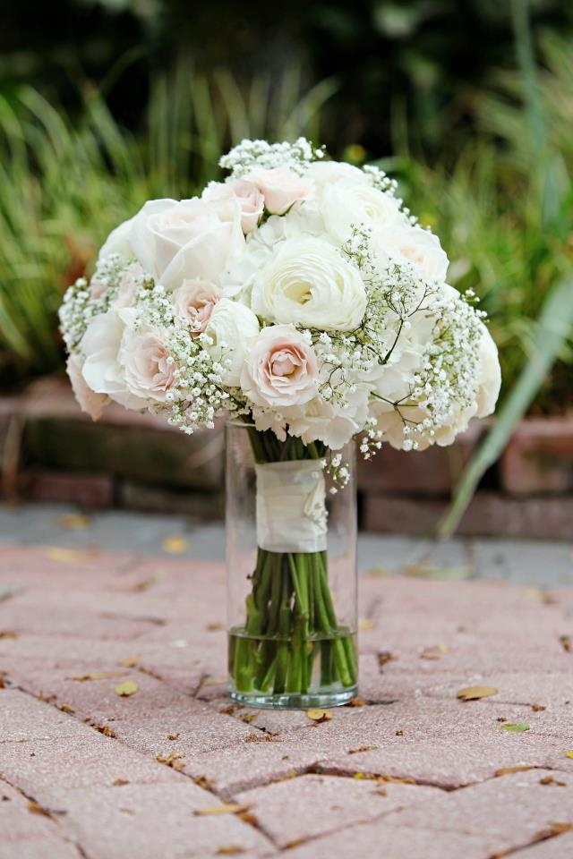 The Plant Shoppe Florist.  Wedding Bouquet White Rose, White Ranaculus, Baby's Breathe & Light Pink Spray roses.  Image by Ryan Caffrey Photography.