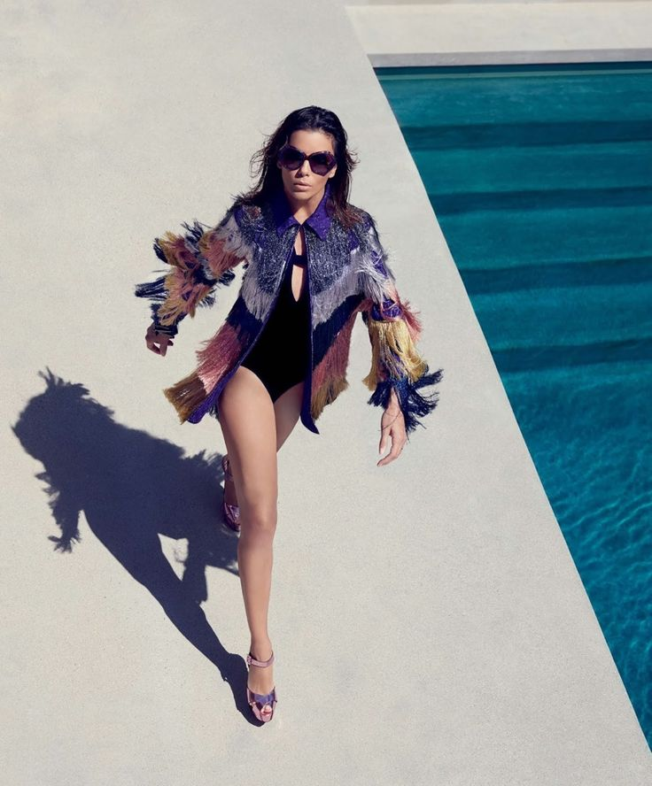 Taking a walk, Eva Longoria wears Missoni fringed jacket with Kopper & Zink swimsuit and Le Silla platform sandals