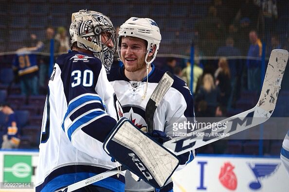Connor Hellebuyck #30 and Andrew Copp #9, Winnipeg Jets