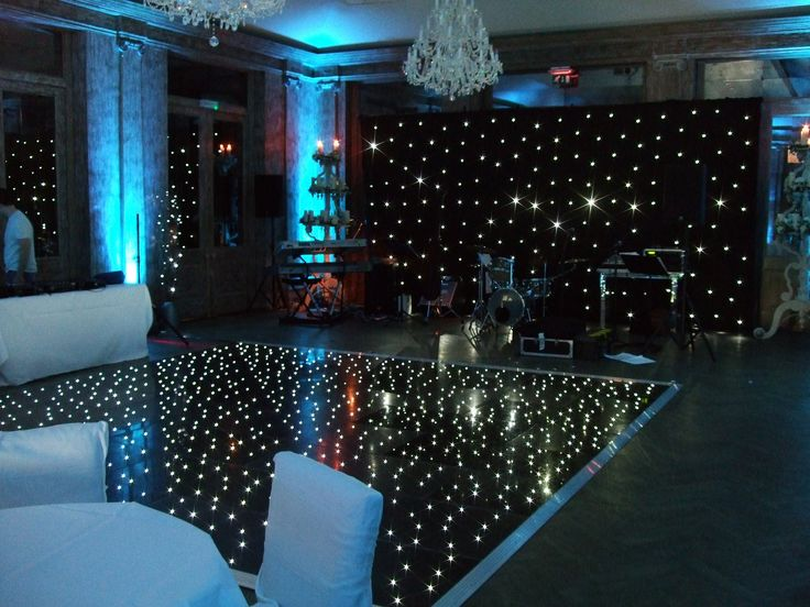 Fawsley Hall Northants - Wall uplighters in ice blue, starcloth backdrop and black starlit dance floor by www.stressfreehire.com #venuetransformers