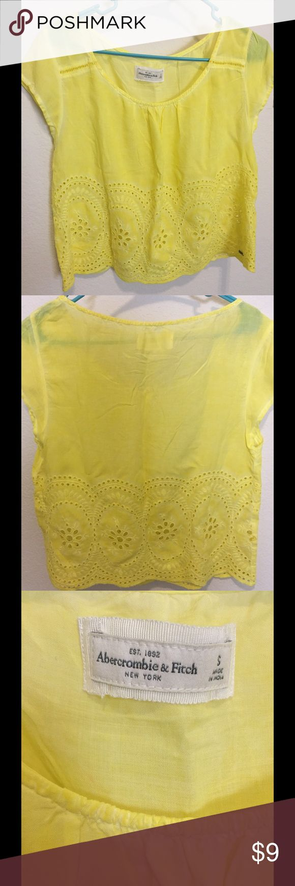 Abercrombie and Fitch Yellow Lace Tee Small Abercrombie and Fitch Lace Top. Has metal emblem on bottom right and Lace bottom. Abercrombie & Fitch Tops Tees - Short Sleeve