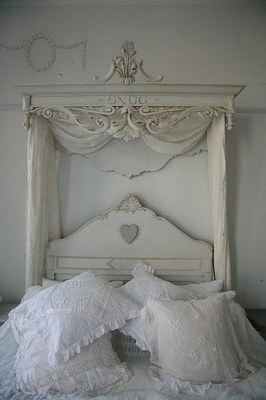 Elegantly time-worn and wildly chic white bedding with a stately, beautiful canopy headboard. #bedroom #elegant #regal #decor #home #shabby #chic #posh #manor #house #European #French