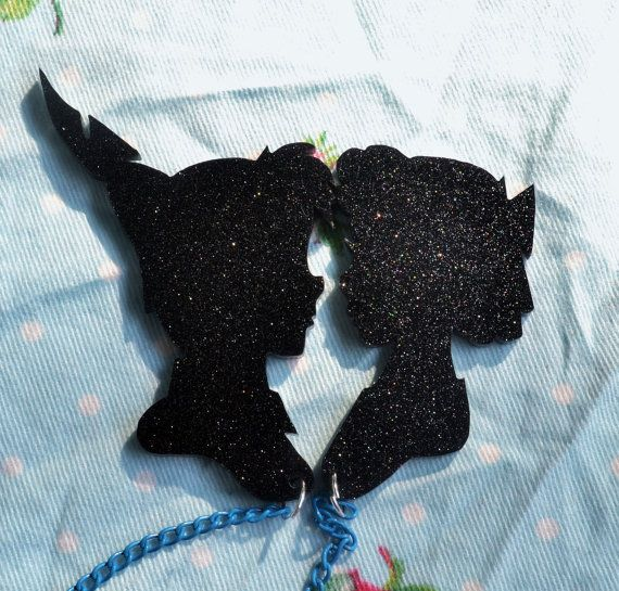 Who doesnt love old school Disney?? The legend of Peter Pan living in magical Never Never Land with fairies and pirates. It was one of my childhood favourites...and not to mention when they released Hook...one of my all time favourite films. These silhouettes of Peter and Wendy make the perfect pair to make my first lot of cardigan clips. With black glitter acryllic and coloured chains to link them these subtle clips will add something sparkly and special to any outfit.  I hand draw all my…