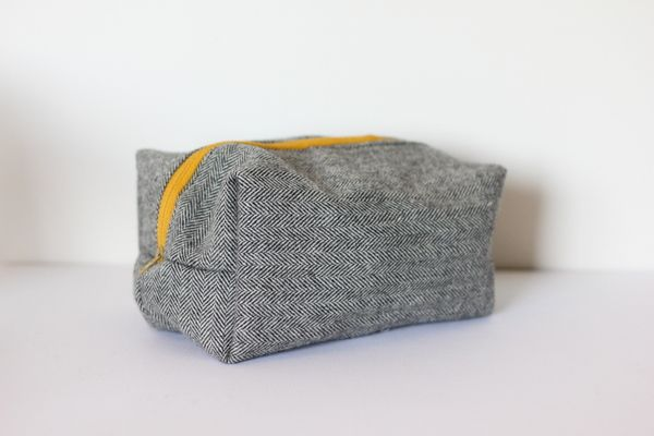 "Make up bag made out of a suit. It's actually supposed to be a ""diaper clutch"" but I have no need for such items."
