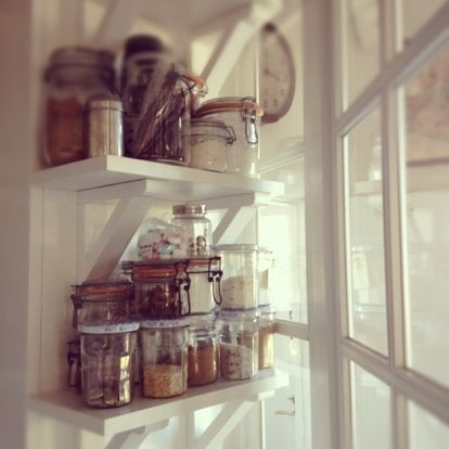 Separate shelves in the kitchen for herbs and such