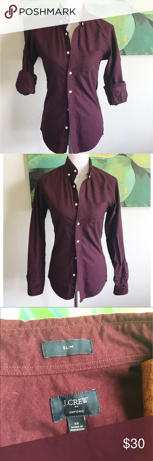 """J. crew oxford blood button down casual shirt Sm Women's J. Crew button down oxford slim fit shirt with beige button detail. Item is preowned and in great condition. Material is 100% cotton. Made in Mauritius 🇲🇺. Thicker material, little stretch (similar to corduroy). Size XS. Item measures 16.5"""" across chest (underarm to underarm) when garment is laid flat. J. Crew Tops Button Down Shirts"""