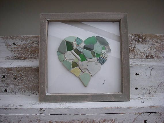 A totally unique mosaic heart made from green sea tumbled beach pottery and sea glass. Most pieces are beach finds from beachcombing on the Menai Straits. Perfect for a special gift for someone you love... for a wedding, anniversary, engagement or birthday. The frame measures 9 x9 inches and is distressed wood effect. I can gift wrap the picture and it will be packaged well for safe delivery.