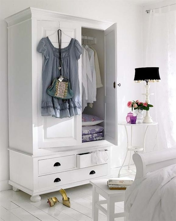 Bedroom Storage - repurposed armoires and cabinets used as closet storage - Cute and Company