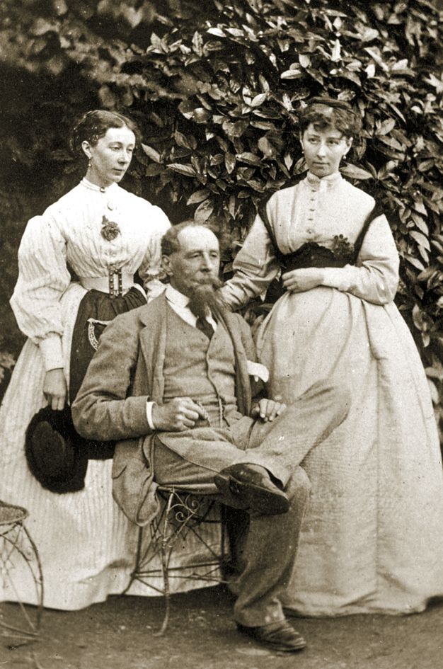 Charles Dickens with his two daughters, Mamie and Katey (right) in c.1865, in the garden at Gad's Hill Place in Kent.