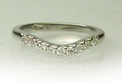 Chibnalls custom made wedding ring with diamonds in 18ct white gold.