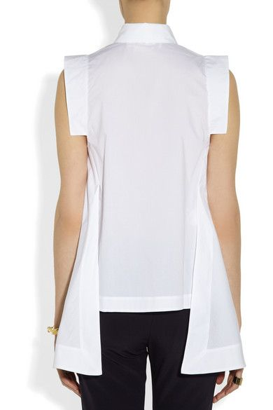 White cotton-poplin Split sides, dipped front hem Concealed snap fastenings through font 100% cotton Dry clean