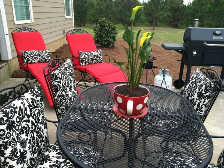 like this classic color combo - Waverly black and cream damask accented  with red. Furniture is standard black wrought iron. - 25+ Best Ideas About Iron Patio Furniture On Pinterest