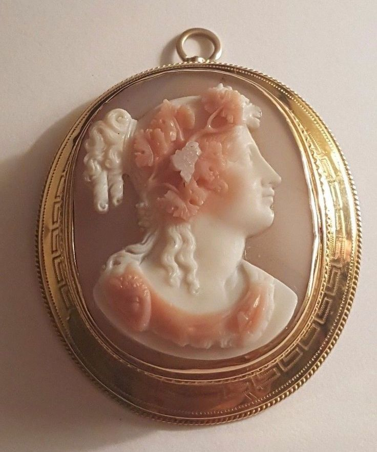 """FABULOUS ANTIQUE HARDSTONE CAMEO PIN pendant 18K GOLD HALLMARKED $1,499.99 Approximately £1,173.98 ANTIQUE HARDSTONE CAMEO PIN PENDANT WITH GRAPES AND RAM MOTIF (ON SHOULDER) IN TESTED 18K GOLD + FRAME.  THE FRAME IS HALLMARKED, BUT I CANNOT MAKE OUT THE TWO HALLMARKS.  IT IS 1 3/4"""" X 1 1/2."""" EXCELLENT CONDITION"""