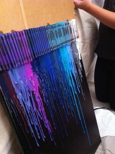 Melted crayon art! so THATS how they do it without the crayons glued to the actual back!!