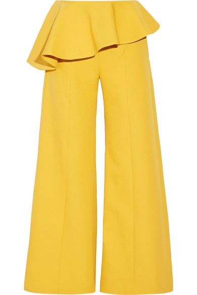 "Rosie Assoulin describes designing as ""an appreciation of the transcendent nature of beauty in all its forms."" Cut from marigold cotton-twill, these bold pants have a rippled peplum overlay and elongating wide-leg cuffs. Balance proportions by styling yours with a fitted top and sandals."
