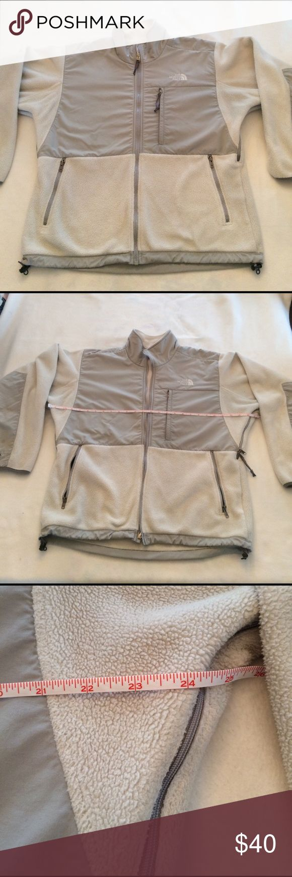 """North Face ladies jacket. Size Large ( fits a generous 14) grey zip front with side underarm zip vents . 22"""" across adjustable bottom. 24"""" across chest. Tiny spec by left shoulder and some pilling inside on back bottom as shown . North Face Jackets & Coats Utility Jackets"""