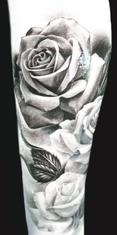 Black and grey roses by Eric Marcinizyn #InkedMagazine #inked #ink #art #tattoos #tattoo #roses
