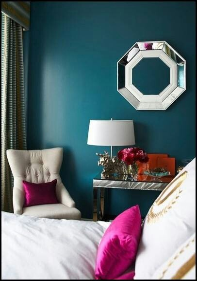 Teal wall with cream furniture to add contrast! very dark teal