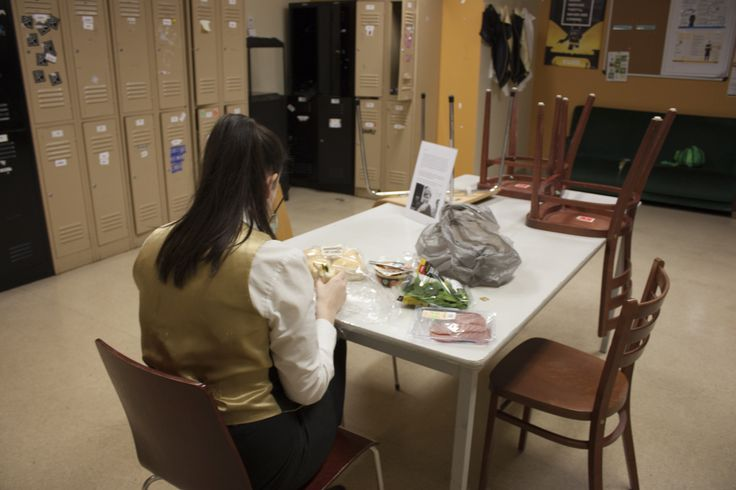 This image was taken at their staff room. This lady was named Molly and she was having lunch on her break. I like all the little things that are happening in the picture with the chairs and the food.