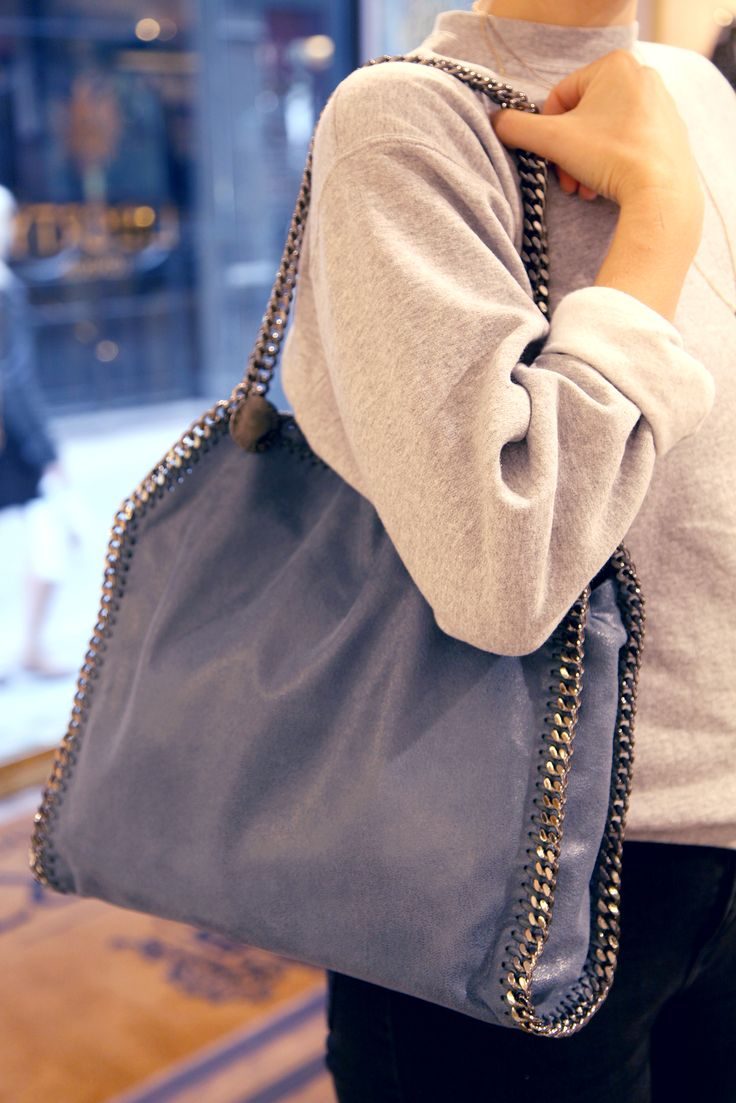 An iconic bag with serious wearability. This fresh colour and gunmetal chain edging lends itself perfectly to luxe off duty dressing, pair with a crisp white shirt and dark indigo jeans for a glamorous weekend look. The Falabella Small Tote from Stella McCartney Liberty.co.uk