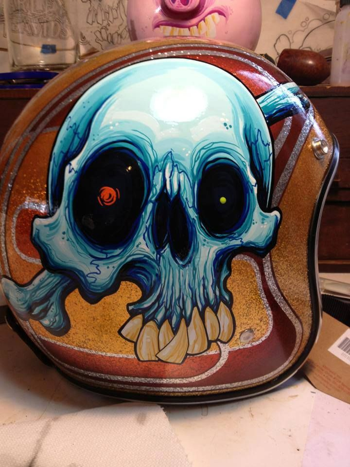 Dave Attonito from GoodClean Fun Tattoo's Biltwell gold flake Novelty helmet painted for this year's Skull Canvas helmet art show.