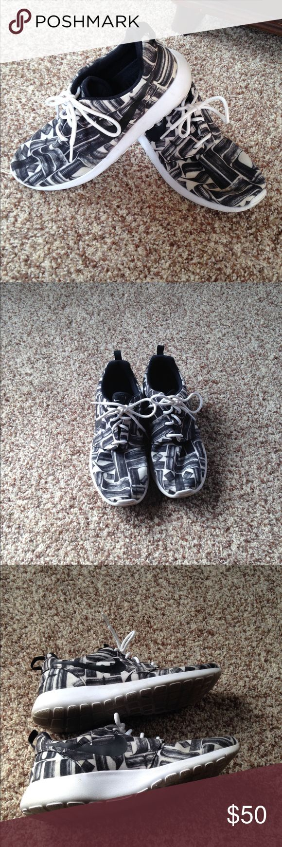 Nike Roshe Black/White print Nike Roshes in a fun black and white print. Gently worn. Majority of the wear is on the bottom of the shoes shown in the photo. Women's 9 Nike Shoes Athletic Shoes