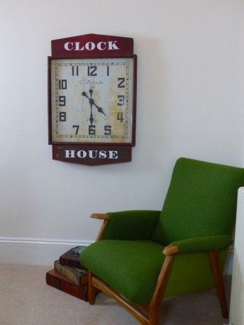 Quirky red antique wall hanging station clock in old aged red paint for hanging on your interior wall for that nostalgic home and work place call Smithers