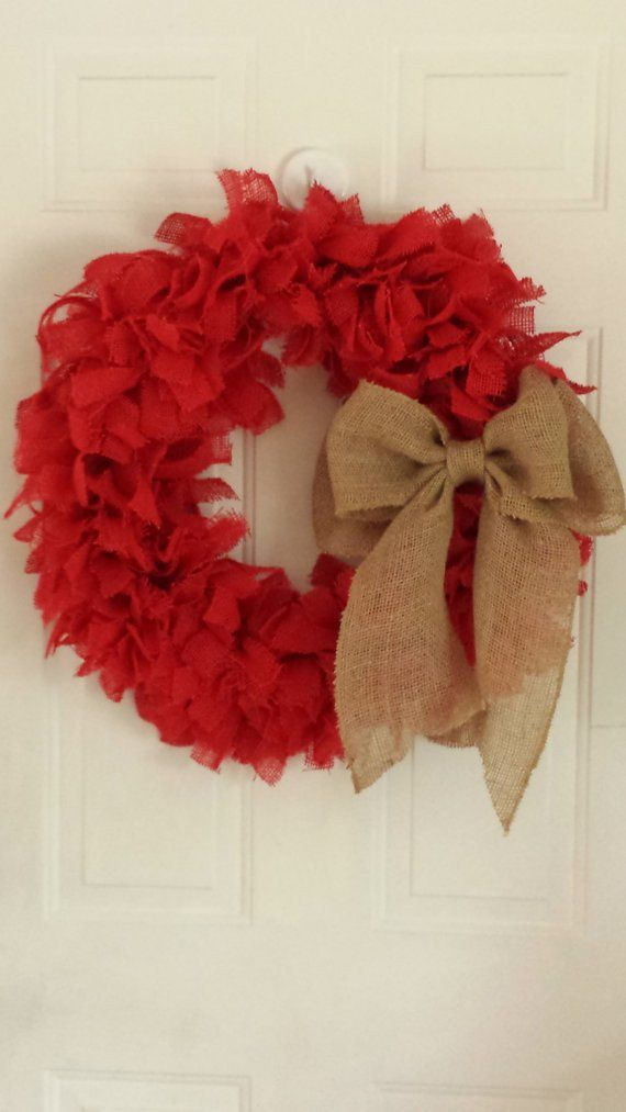 """This full and fluffy burlap wreath is hand tied with strips of red burlap. The wreath form is 18"""" but measures approximately 24"""" in diameter completed. Adorned with a large, natural burlap bow. Please"""