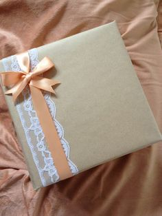 Pretty with christmas colors! Light blue wrapping paper with white polka dots, white, and red ribbon.