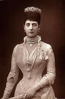 Princess Alexandra of Denmark, taken in 1889. Gorgeous dress but look at that hair-not a strand out of place and fits her crown perfectly.