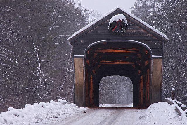 Corbin Covered Bridge The Corbin Covered Bridge in Newport, NH, in a light snow storm. It's still wearing it's Christmas decoration.
