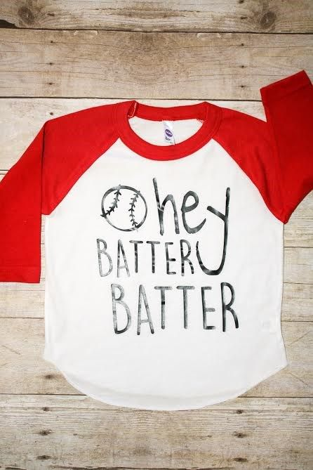 Hey Batter Batter!! Your little baseball fan will look adorable in this tee.Printed on an American Apparel brand 3/4 sleeve raglan style tee.White body with red sleeves.Sizes ranging from 3 months to 6 Years.