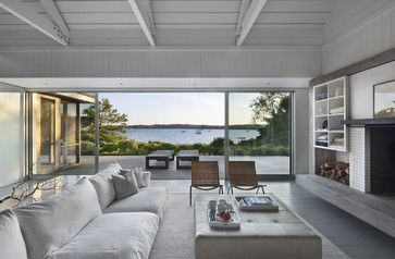 "Going with a simple color scheme lets the natural materials and the views stand out. Driftwood, a found branch and wood trusses and planks add up to what Coastal Modern author Tim Clarke dubs ""Scandia Surf,"" a look that embraces pleasing proportions, uncluttered spaces and natural materials."