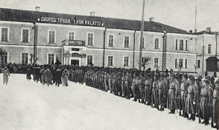 """""""Reds"""", 1928. The (Communist) Karelian Jäger Battalion on parade in Petrozavodsk. A build up of military forces ensued on both sides between the two world wars. The totalitarianism in Finland noted in the 1980s and 1990s is mostly a product of the German side (Jaegers), followed by Italy's Fascist influences and WW II's preachings of Mussolini. The Communist socialism in turn came due to Russia (in this photo)."""