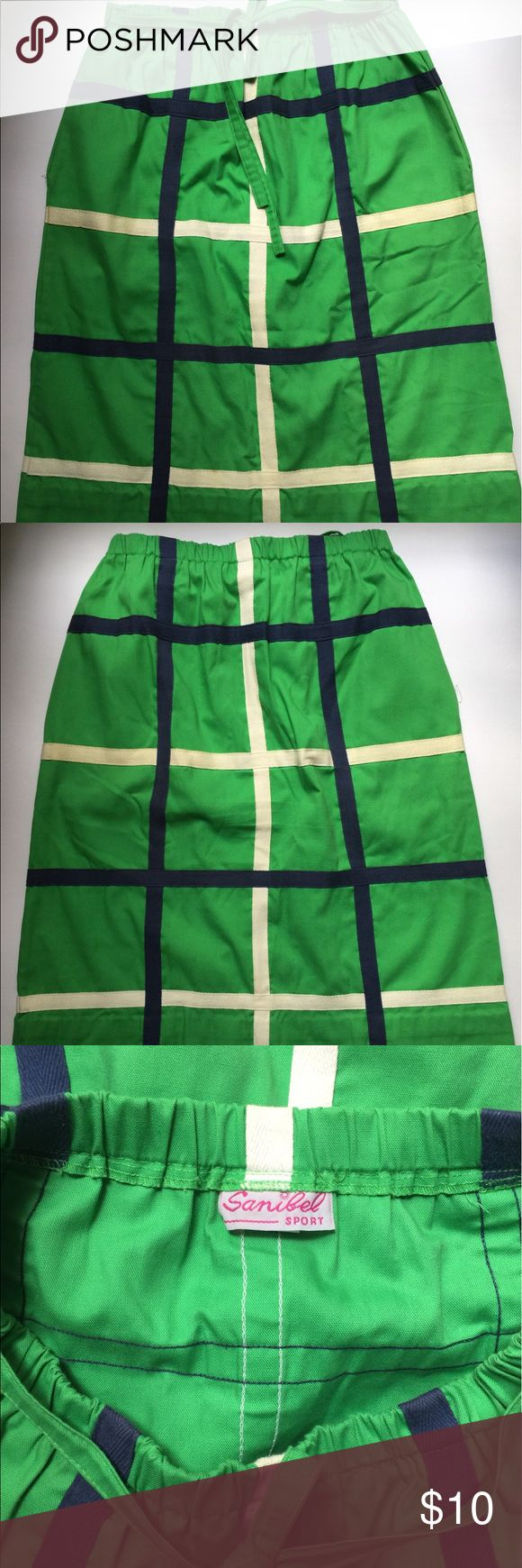 "**Vintage** SANIBEL SPORT Kelly Green Skirt Women's SANIBEL SPORT Kelly green with navy blue and white ribbon detail.  Elastic waist, tie, and 2 front pockets.  Size:  Unmarked Measurements: Waist = 14"" Length = 26"" Hips = 22""  In overall good vintage condition.  There are 2 small stains on the bottom front of the skirt, loose stitching both pockets and some discoloration on left rear white ribbon detail (please see photos). Sanibel Sport Skirts"