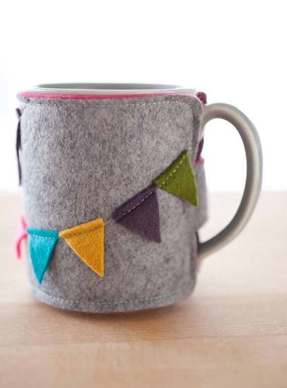 coffee mug cozy.    Cool weather is here, the perfect time for a hot mug of tea or coffee! This cute cozy will protect your hands from your hot mug, and make your drink look stylish!  The lovely bunting banner pattern wraps around the cozy. A velcro closure keeps it secure...No banner and no velcro would be ideal!