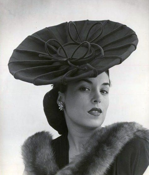 A fantastic hat worn by Havana socialite Aline Johnson de Menocal. Photograph by Nina Leen. Havana, Cuba, 1946.
